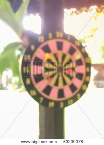 Dartboard blur is the target and Dart is an opportunity blur on success. represent a challenge. Bullseye and Dart. opportunity. risk management. business concept.