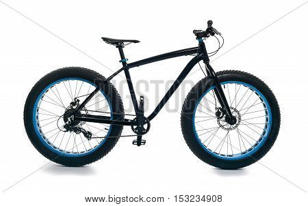 Fatbike also called fat bike or fat-tire bike - Cycling on large wheels. Isolate. Side view the full size.