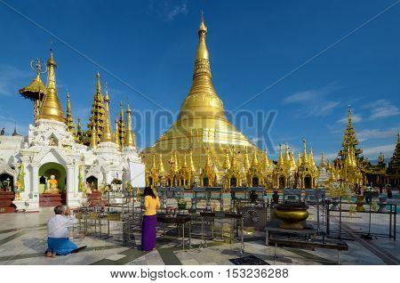 Myanmar Buddhists make worship to The Shwedagon Pagoda the Great Dagon Pagoda and the Golden Pagoda.