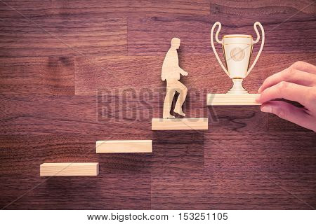 Personal development, personal and career growth, progress and potential concepts. Coach (human resources officer, manager, mentor) motivate employee to growth with cup.