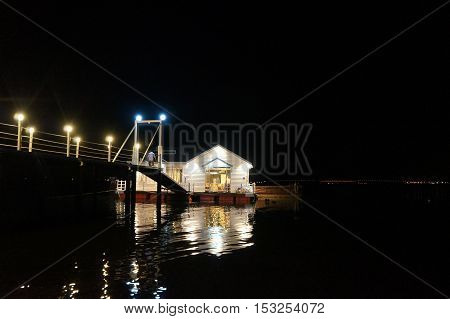 small house, cafe, building on the sea at night