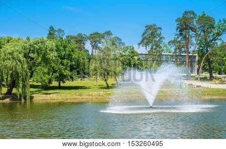 Photo of a fountain in the park. Debrecen Hungary.