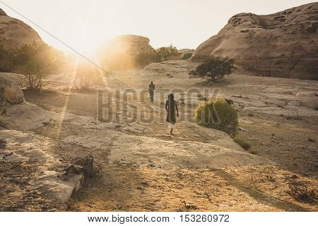 PETRA JORDAN - AUGUST 14 2016: unidentified bedouin walk on top of the hill near little Petra. Trekking on the mountains are one of the attractions of Jordan