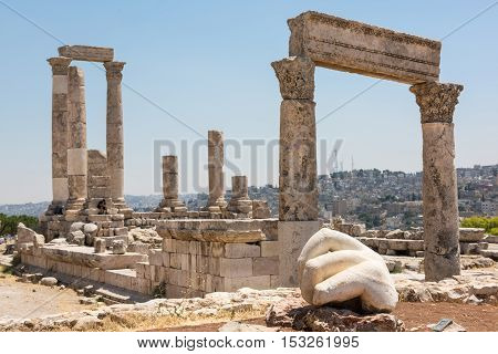 Ancient ruins of a roman temple in the Citadel of Amman. The hand of a statue in the foreground
