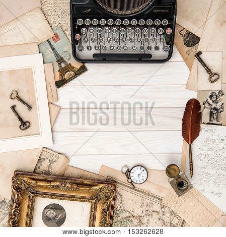 Antique typewriter and vintage office accessories on wooden table. Flat lay still life