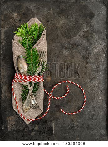 Christmas decoration. Festive arrangement with christmas tree brunches on grungy background