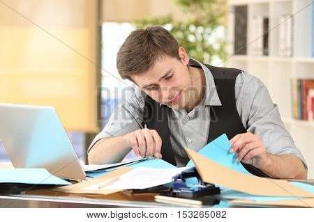 Incompetent messy businessman with disorganized desk searching lost documents at office