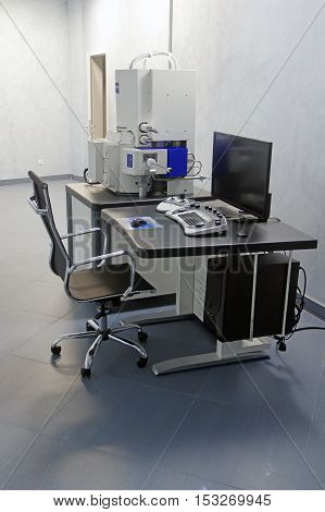 operator's station electronic microscopein a scientific institution
