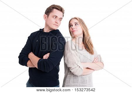 Couple Looking At Each Other With Arms Crossed
