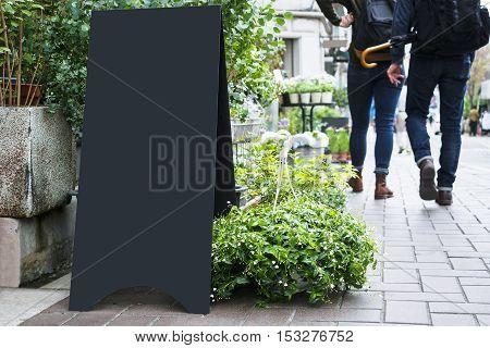 Blank Board stand mock up Black metal Signage Outdoor People walking sidewalk Shop