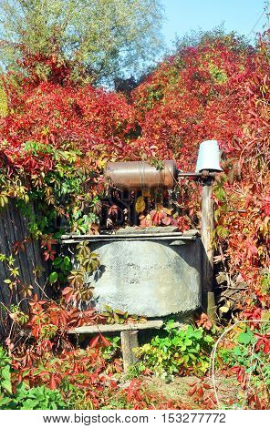 old water well with pulley and bucket for your design