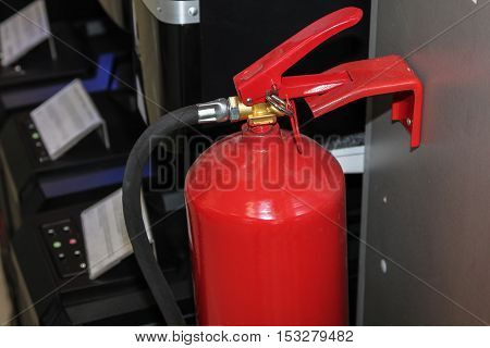 Red fire extinguisher in the office building