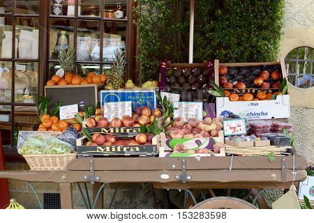 BROADWAY, UK - AUGUST 18, 2016 - A fruit stand outside a Cotswolds village shop, Broadway, Cotswolds, UK