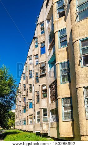 View of a Soviet-era apartment building in centre of Bishkek, the capital of Kyrgyzstan poster