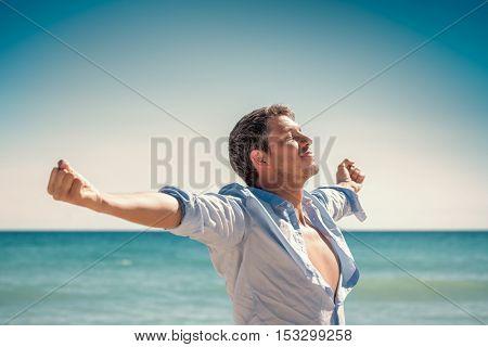 joyful happman rising arms for success