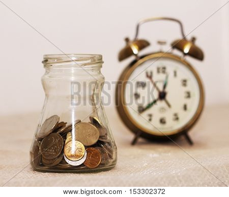 Alarm clock and money golden and retro object.