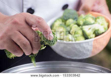 Chef putting broccoli hot water / Stir fry Broccoli concept