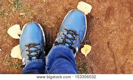 Blue shoes. Men's stylish shoes. Fashionable autumn. Jeans