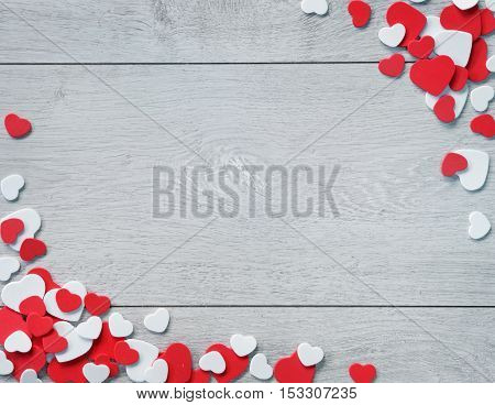 Wooden Background for design to Valentine's Day. Decorative red and white hearts. View from above. Valentines Day concept