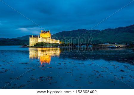 Stunning Illuminated Eilean Donan Castle At Dusk, Scotland