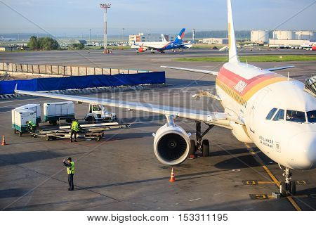 Moscow, Russia - May 27, 2016: Luggage loading of Iberia airlines aircraft before boarding  at the Domodedovo airport in Moscow, early morning