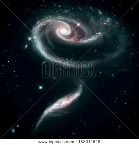A Rose Made of Galaxies UGC 1810 and UGC 1813. Group of spiral galaxies in the constellation Andromeda. Elements of this image furnished by NASA.