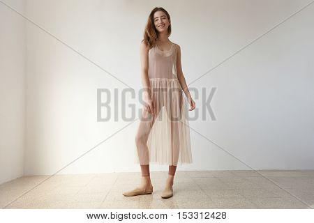 Woman In Loft Studion In Transparent Ballerina's Dress