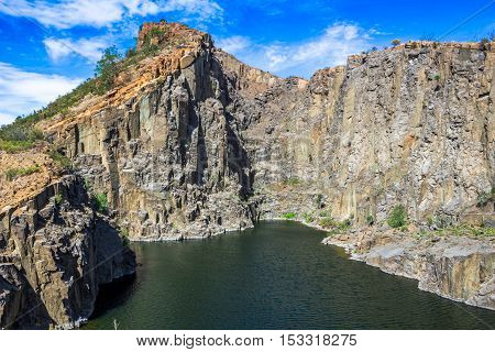 Old unused water filled dolerite rock quarry
