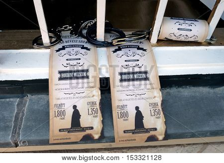 BUDAPEST HUNGARY - SEPTEMBER 29 2016: Window Houdini Museum decorated bars handcuffs and entrance tickets