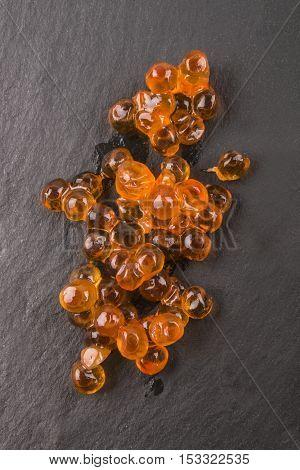 fresh salty orange salmon caviar on slate