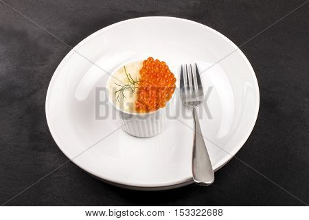 fine dinning with a small bowl mashed potato salmon caviar dill and fork