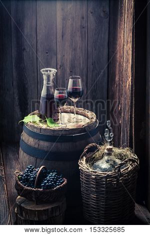 Fresh Homemade Wine In Glass With Grapes And Demijohn