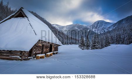 Old Wooden Cottages In Winter Mountains, Poland