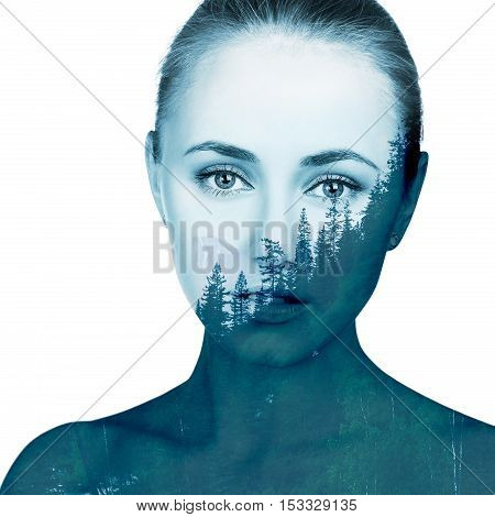 Double exposure portrait of beautiful young woman and forest.