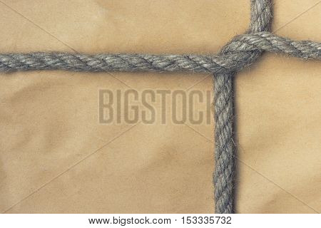 A parcel is bandaged by a rope