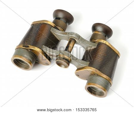 The old shabby binoculars shot on a white background