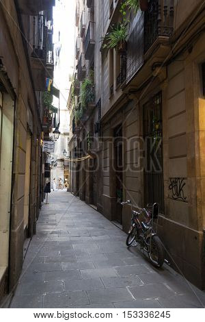 Narrow Street In The Gothic Quarters Of Barcelona