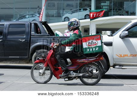 CHIANGMAI THAILAND - OCTOBER 8 2016: Delivery service man ride a Motercycle of The Pizza Company. In Busy Traffic On road no.1001 8 km from Chiangmai Business Area.