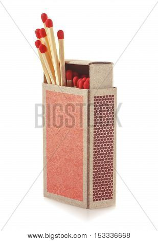 Matches protruding from the box. Isolated on white background. Soft focus.