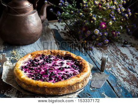 Homemade Pie With Bilberry On Old Wooden Table.