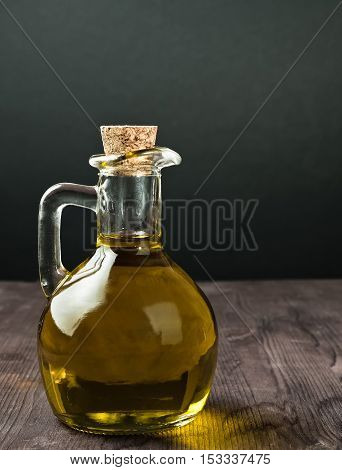 Olive Oil Container Bottle With Stopper On Wood Table Background