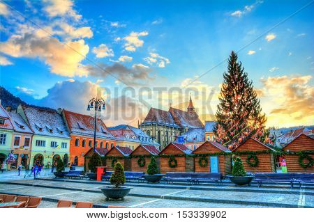 Beautiful panorama in Brasov town in Christmas market time at sunset