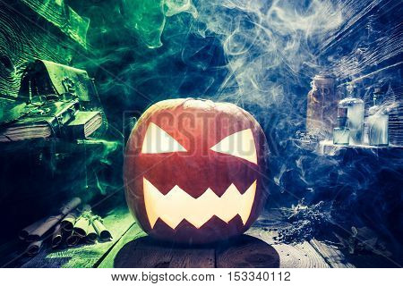 Scary Halloween Pumpkin With Blue And Green Smoke In Witcher Hut