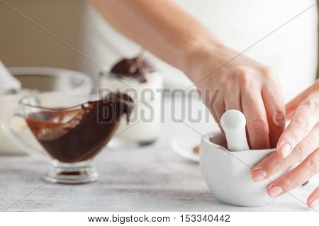Homemade Chocolate Syrup Dripping From A Spoon Into A Bowl / A Master Class In Cooking Chocolate