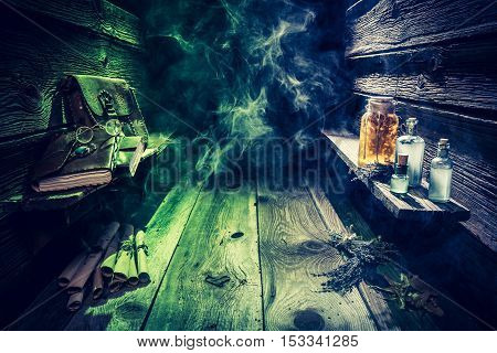 Witch Hut With Potions, Scrolls, Books And Blue, Green Smoke With Copy Space For Halloween