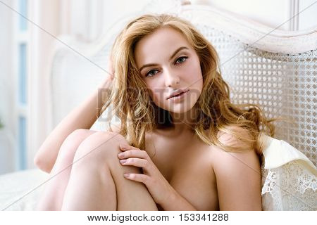 Beautiful Nude Sexy Lady In Elegant Pose. Fashion Portrait Of Girl Indoors. Closeup Beauty Blonde Wo