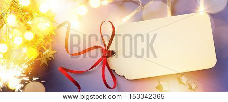 Merry Christmas card with Season Gift Tag on blue background