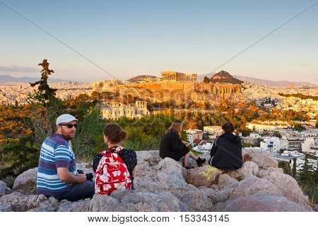 ATHENS, GREECE - OCTOBER 24, 2016: Evening view of Acropolis from Filopappou hill in central Athens on October 24, 2016.