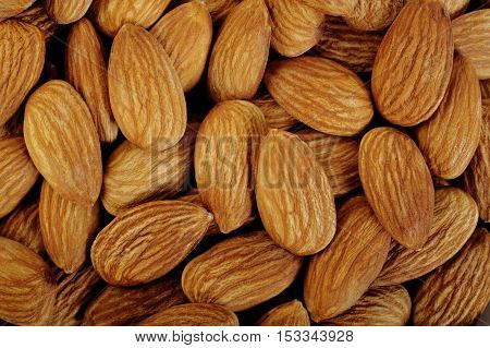 Close up almonds nuts at on background