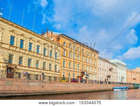 SAINT PETERSBURG RUSSIA-OCTOBER 3 2016. Historic buldings and embankment of Moika river in sunny weather in Saint Petersburg Russia. Architecture city landscape of Saint Petersburg Russia